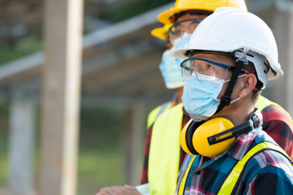 Workers,Wear,Protective,Face,Masks,For,Safety,Working,In,Solar